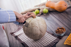 Woman in kitchen making prepares a pie with pumpkin Stock Photography
