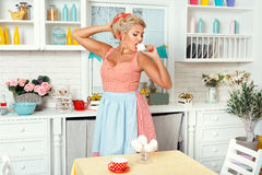 Woman in the kitchen with meringue. Stock Images