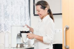 Woman preparing coffee royalty free stock images