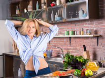 Woman on kitchen playing with greed onion royalty free stock photos