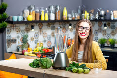 Woman in the kitchen Stock Images