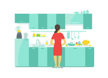 A woman in the kitchen preparation food dishes and tableware saucepan dinnerware Table and kitchen cabinets. A woman in the kitchen cabinets. Preparation food Stock Photography