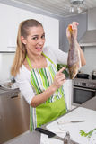 Woman in the kitchen preparing fish dinner with perch - humorous Stock Photos