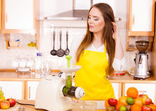 Woman in kitchen preparing fruits for juicing Royalty Free Stock Photos