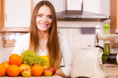 Woman in kitchen preparing fruits for juicing Royalty Free Stock Photo