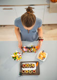 Woman in kitchen preparing halloween trick or treat Royalty Free Stock Image