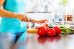 Woman in the kitchen preparing salad Royalty Free Stock Photography