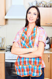 Woman at the kitchen Royalty Free Stock Image