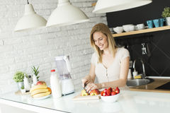 Woman in the kitchen Stock Image