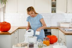 Woman in kitchen with pumpkins Royalty Free Stock Image