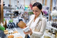 Woman at a kitchen store in shopping mall Royalty Free Stock Image