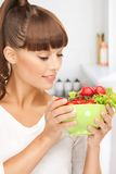 Woman in the kitchen with tomatoes Royalty Free Stock Image