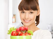 Woman in the kitchen with tomatoes Stock Image