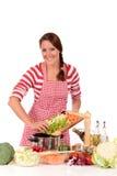 Woman kitchen vegetables Stock Photos