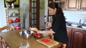 Woman In The Kitchen stock video footage