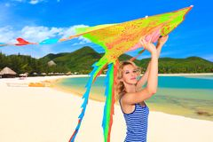 Woman with kite Royalty Free Stock Image
