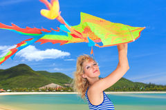 Woman with kite Stock Images