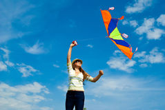Woman with kite Stock Photo