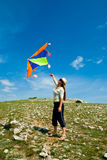 Woman with kite Royalty Free Stock Photo