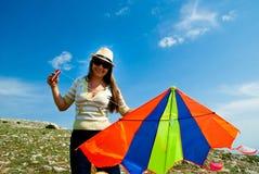 Woman with kite Stock Image