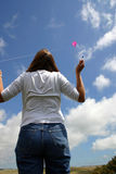 Woman and kite. Woman flying a kite Stock Photography