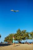 Woman with kite Stock Photo