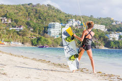Woman kite-surfer ready for kite surfing rides in blue s Royalty Free Stock Photo