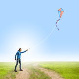 Woman with kite Royalty Free Stock Photography