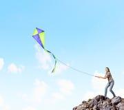 Woman with kite Stock Photos
