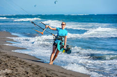 Woman Kitesurfer with Kitesurf power kite on the beach in Ulcin