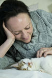 Woman with kitten Stock Image