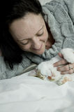 Woman with kitten on bed Stock Image