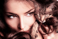 Woman and kitten Stock Image