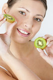 woman with kiwi Royalty Free Stock Image