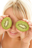 Woman with kiwi Stock Photos