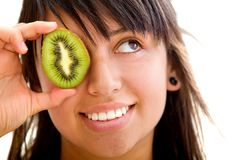 Woman with a kiwi Stock Photography