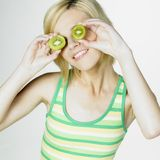 Woman with kiwi Stock Images