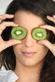 Woman with kiwi eyes Royalty Free Stock Images