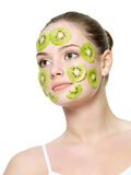 Woman with a kiwi mask on a face Royalty Free Stock Images