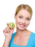 Woman with kiwi near her pretty royalty free stock images
