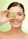 Woman with kiwi slice Stock Photography