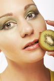 Woman with kiwi on white Stock Photography
