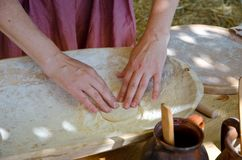 Woman knead the dough for cooking royalty free stock images