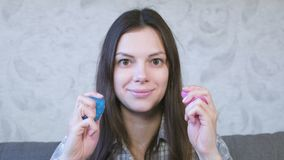 Woman knead, squeeze and stretch a pink and blue slime. Woman plays with slime. Chew gum. stock video
