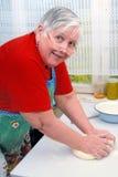 Woman kneading dough Royalty Free Stock Image