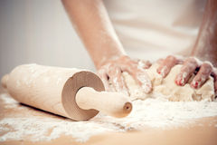 Woman kneading dough. Close-up photo