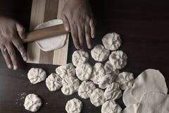 Woman kneading dough cover for empadas stock photos