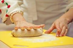 Woman kneading dough Royalty Free Stock Photos