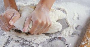 Woman kneading a dough 4k