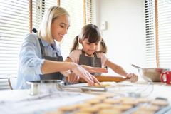 Woman kneading dough on kitchen table. Baking bread royalty free stock images